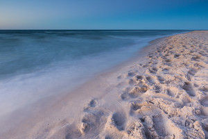 Beautiful Baltic sea beach at sunset. Beautiful seascape with sky reflected in water.
