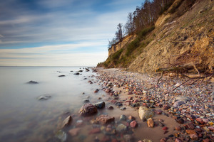 Beautiful Baltic sea shore with big cliff in Gdynia Orlowo. Seashore long exposure photo.--