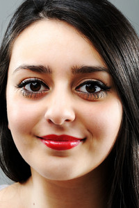 Beautiful brunette girl face smiling