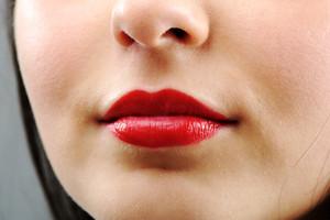 Beautiful brunette lips closeup