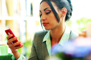 Beautiful businesswoman using smartphone