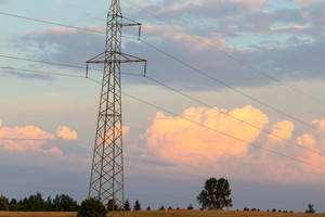 Beautiful cloudscape and field with power poles