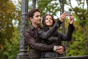 Beautiful couple making selfie photo