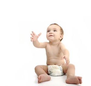 Beautiful cute happy baby isolated on white background. Wearing diaper, large copy-space for your message.