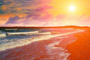 Beautiful deserted beach at sunset