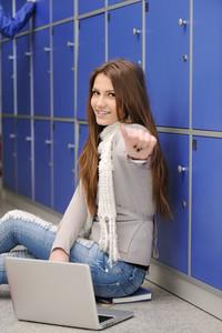 Beautiful female blond student inside the university