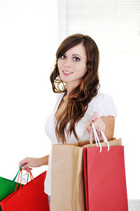 Beautiful girl holding many shopping bags and smiling