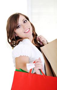 Beautiful girl holding many shopping bags
