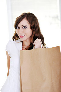 Beautiful girl holding shopping bag