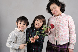 Beautiful kids with red rose