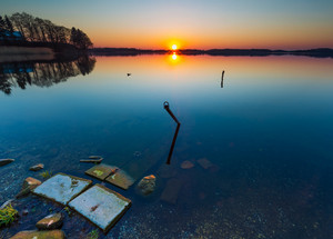Beautiful lake at sunset. Boats mooring place.Tranquil scene photographed in Poland.