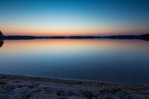 Beautiful lake at sunset. Tranquil scene photographed in Poland in Mazury lake district. Typical polish lake landscape.