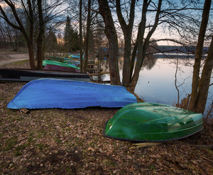 Beautiful lake landscape with boats on shore. Polish lake in Mazury lake district.