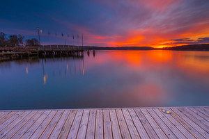 Beautiful lake landscape with vibrant sunset. Long exposure landscape.
