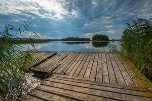 Beautiful lake with old destroyed jetty. Lake near Olszty in Poland