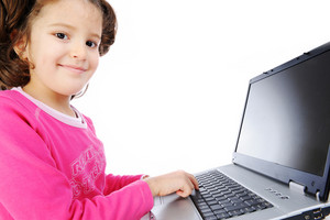Beautiful little girl isolated with laptop