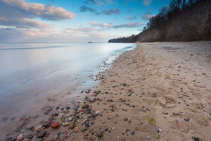 Beautiful long exposure landscape of rocky sea shore. Tranquil scene of Baltic sea near Gdynia in Poland.