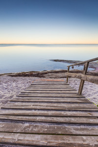Beautiful morning landscape with wooden stairs leading to the sea. Landscape of beach in Jastarnia
