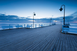 Beautiful morning seascape with wooden pier. Pier in Orlowo