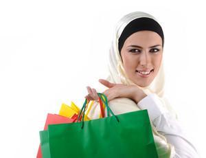 Beautiful Muslim traditional but modern woman holding shopping bags