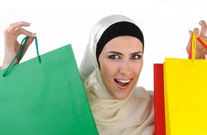 Beautiful Muslim traditional but modern woman holding shopping bags
