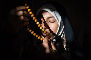 Beautiful Muslim young woman in darkness
