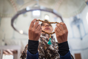Beautiful Muslim young woman praying in masjid