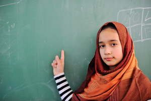 Beautiful muslmi girl in front of blackboard