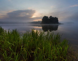 Beautiful mystic sunrise over lake. Summertime in Mazury lake district.