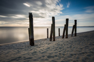 Beautiful piece of old destroyed pier in Gdynia poland. Seascape with wooden molo in Orlowo.