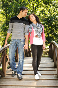 Beautiful scene of two teen lovers in nature, young couple together walking together