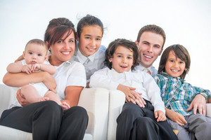 Beautiful smiling family outside portrait