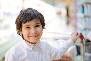 Beautiful smiling kid in supermarket