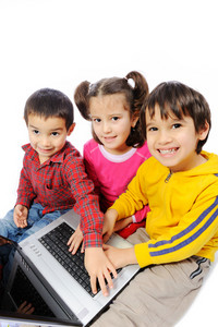 Beautiful smiling kids playing with laptop