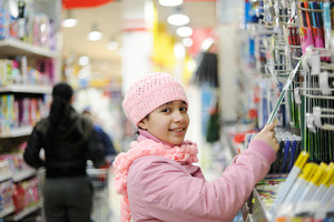 Beautiful smiling little girl in shopping