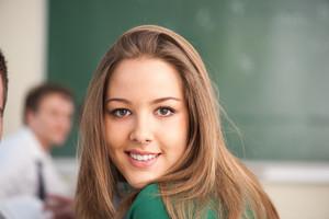 Beautiful smiling schoolgirl in a classroom