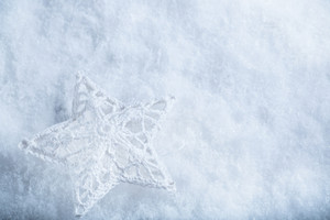 Beautiful star on a white frost snow background.