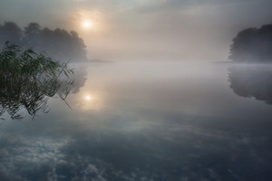 Beautiful sunrise over lake with reflections in water
