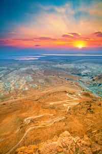 Beautiful sunrise over Masada in Judaean Desert.