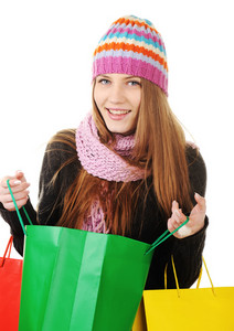 Beautiful winter girl with shopping bags