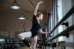 Beautiful woman dancing in ballet class