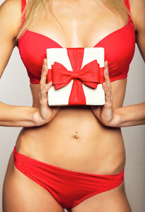 Beautiful woman in underwear holding a gift