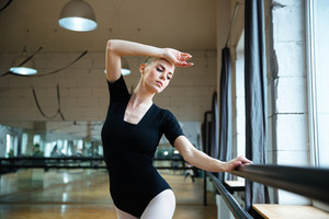 Beautiful woman practicing in ballet class