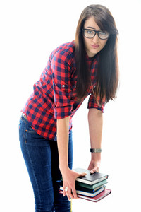 Beautiful young caucasian girl with glasses isolated on white lifting a pile of books