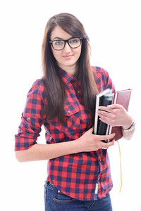 Beautiful young girl with glasses holding books