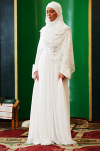 Beautiful young oriental bride preparing for wedding