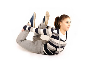 Beautiful young woman makes stretching isolated over white background