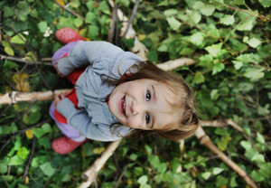 Beauty blond baby on tree leaves ground