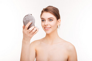 Beauty portrait of a happy woman holding mirror isolated on a white background