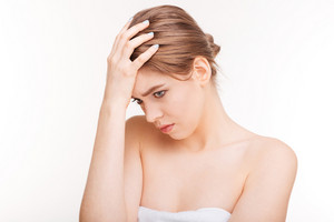 Beauty portrait of a stressed woman standing isolated on a white background